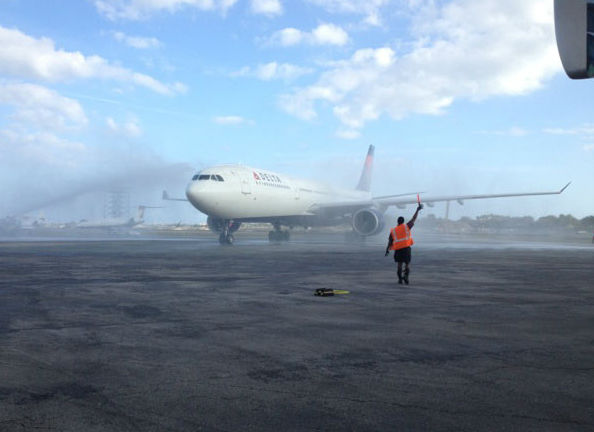 The Notre Dame team plane gets a water cannon salute after landing at Ft. Lauderdale International Airport, Wed., January 2, 2013. <span class=meta>(Rafer Weigel)</span>
